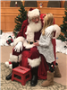 Little girl telling Santa Claus her wish list