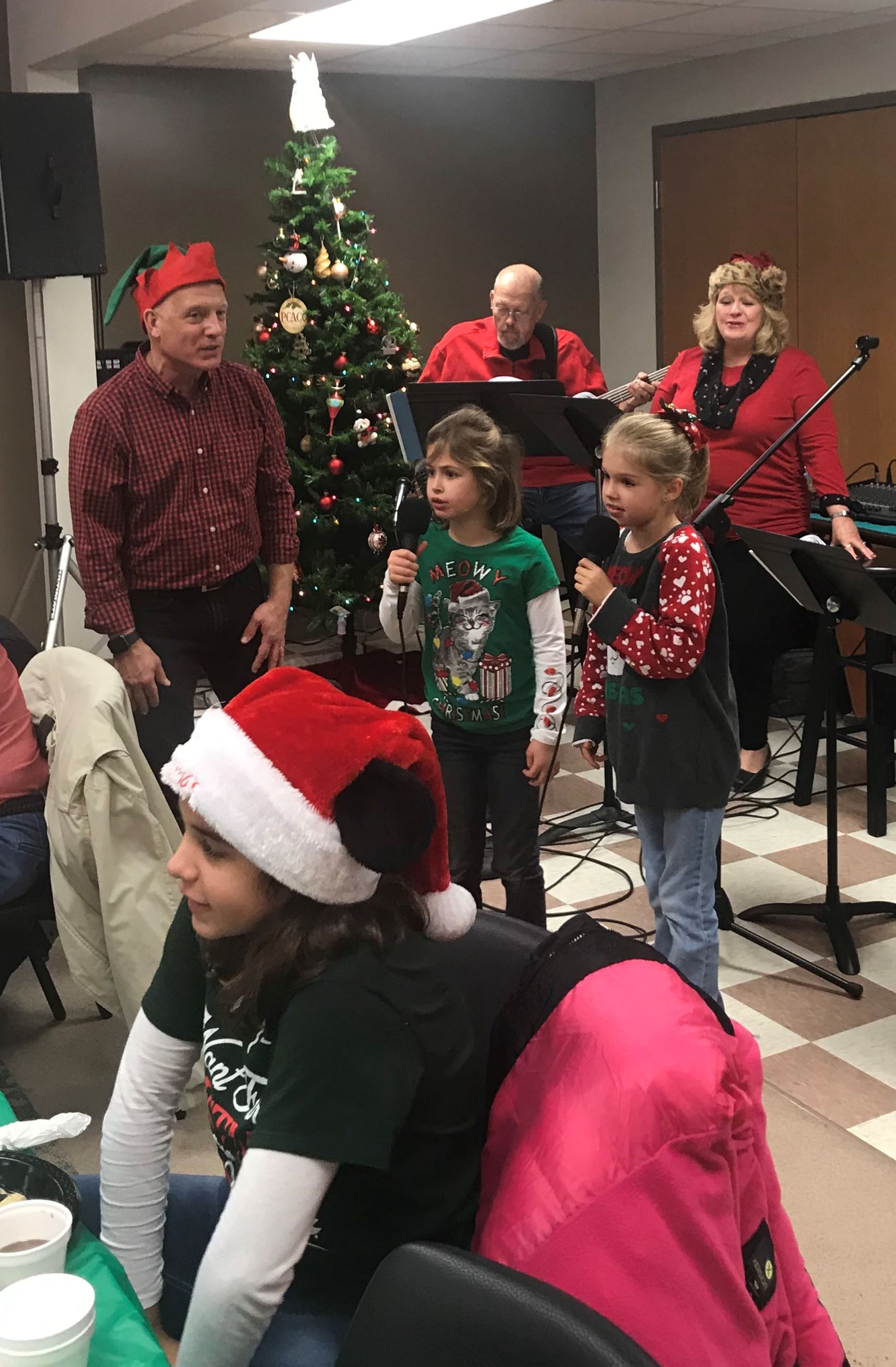 The band and kids singing carols